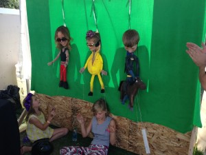 Moving and dancing puppets to music from karaoke pop to classic rock, Urban Arts visitors at the Utah Arts Festival enjoy Spy Hop's 'human puppets.'