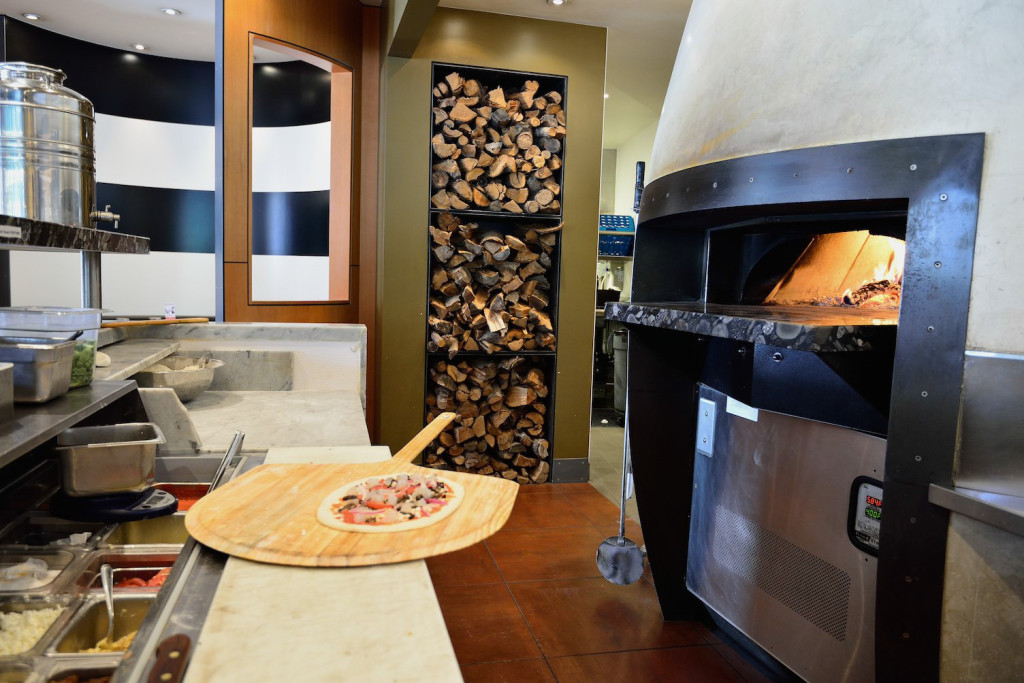 The wood-fired oven is the centerpiece of the kitchen.