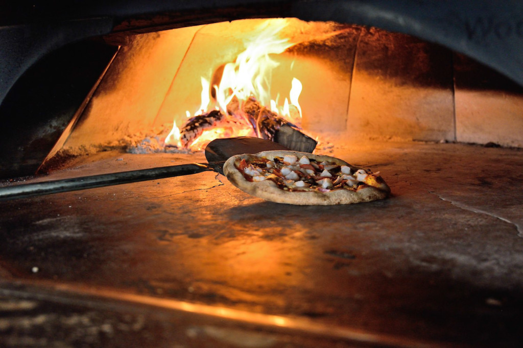 The oven is kept around 600 degrees and can finish cooking a pizza in about five minutes, according to executive chef Trent Campbell.