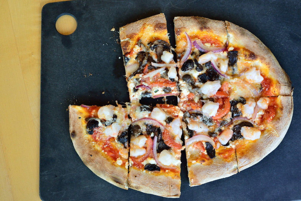 The Vernazza: shrimp, mushrooms, Roma tomatoes, lemon, red onions, mozzarella, goat cheese and parmesan.