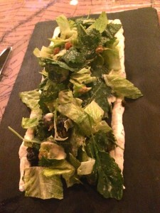 Blueberry, romaine and kale served on a slate