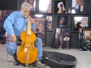 Tim Jenison tries out the viola da gamba that is part of Vermeer's 'The Music Lesson.'