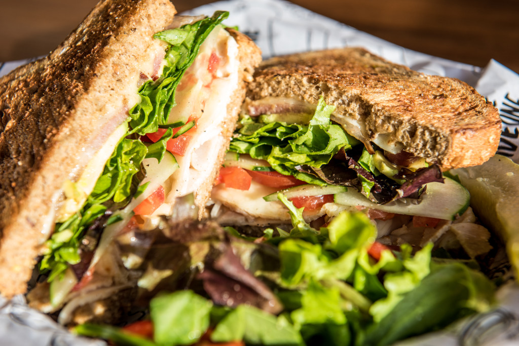 The Sprang Chicken, chicken, provolone, bacon, avocado, tomatoes, cucumbers,greens and  honey-mustard on whole grain bread.