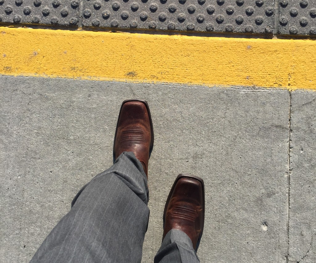 Boarding a downtown SLC TRAX train on my way to work in some new boots.