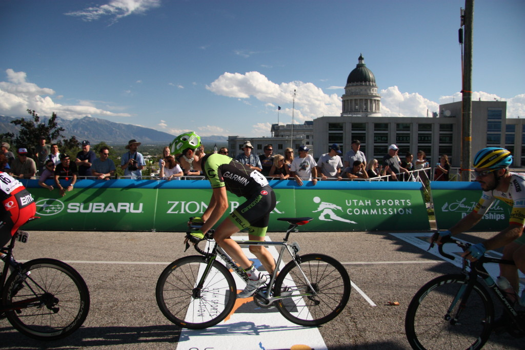 Alex Howes, with Cannondale Garmin, races past the Capitol building