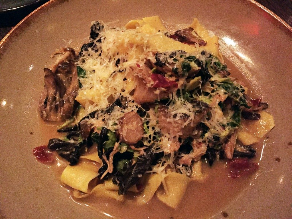 housemade pappardelle pasta studded with braised rabbit and crispy Brussels sprouts