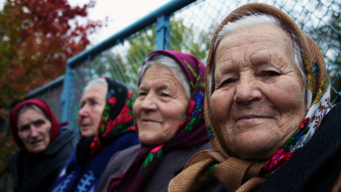 babushkas_group-in-front-of-fence